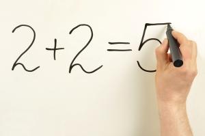 2+2=5 formula written on a board